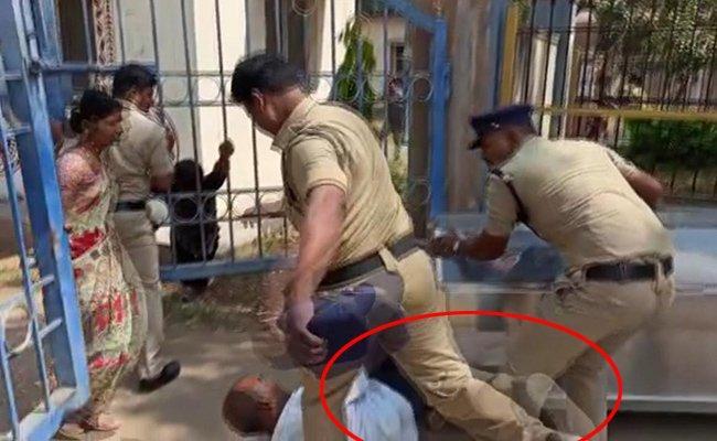 constable Suspended After Kicks Man In Sangareddy - Sakshi