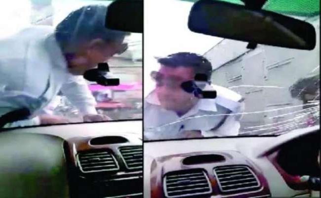 Car Driver Drags Traffic Constable On Bonnet In Delhi - Sakshi