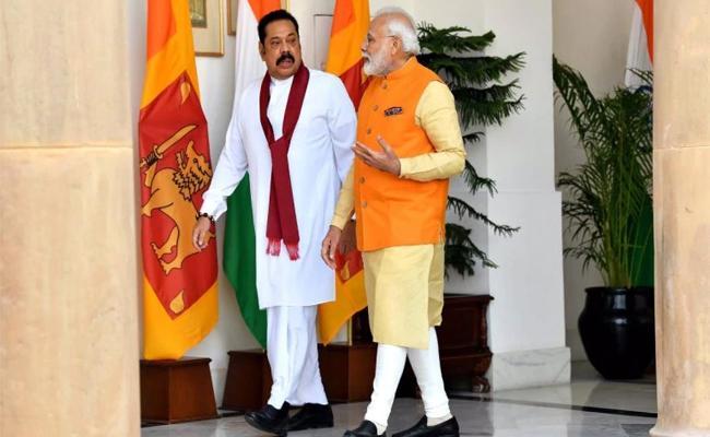 Narendra Modi And Mahinda Rajapaksa Meet With Each Other In Delhi - Sakshi