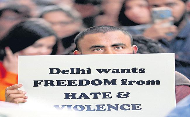 People Want Peace From Delhi Violence - Sakshi