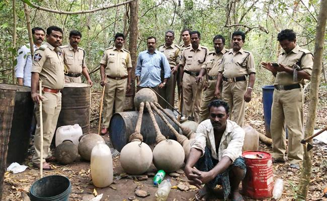 Excise Department Officials Attack on Alcohol Dumps - Sakshi