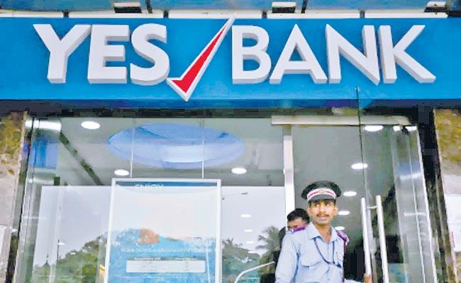 FPIs And investors flag concerns over Yes Bank trading curbs without notice - Sakshi