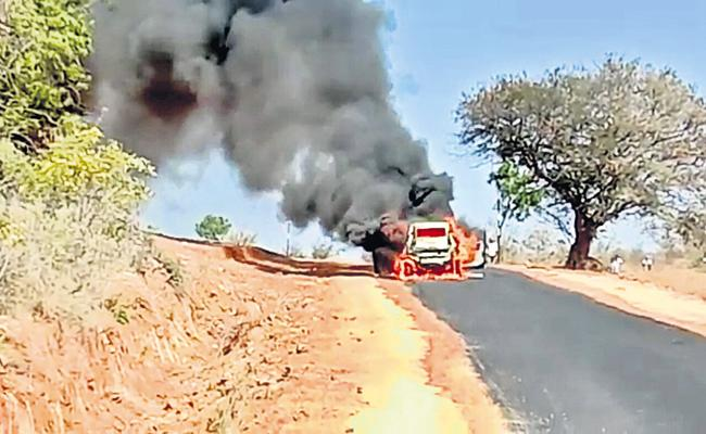 Three escape after car catches fire In Kadthal - Sakshi