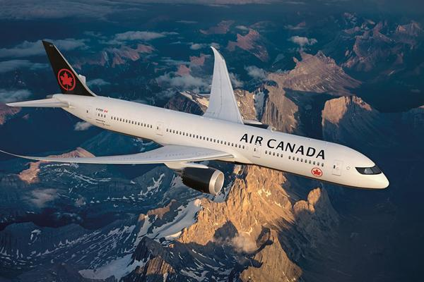 Air Canada To Lay Off Employees Due To Coronavirus - Sakshi