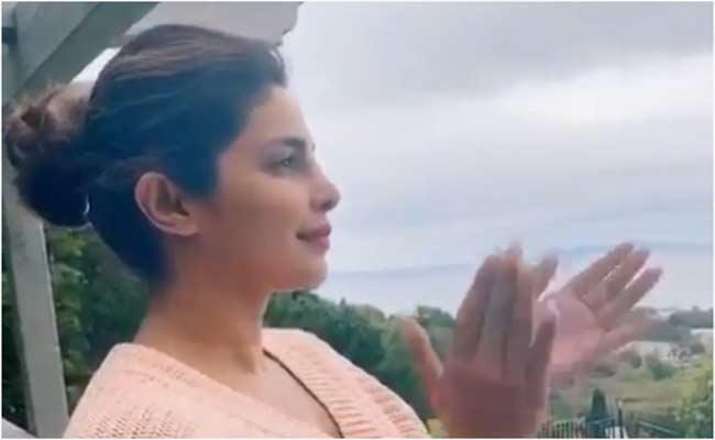 Priyanka Chopra Shares Video Of Joins Janata Curfew From USA - Sakshi