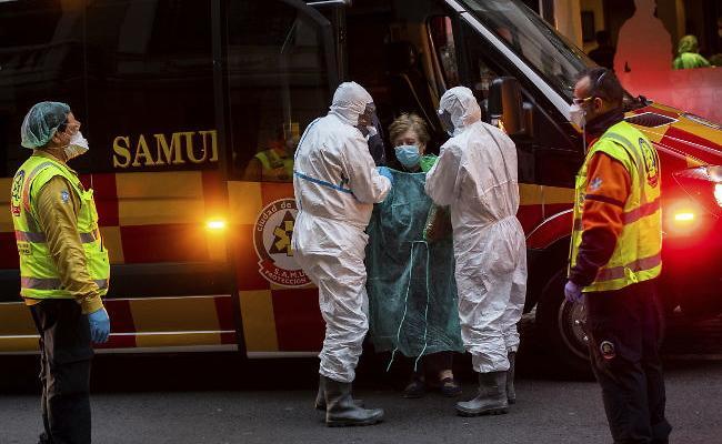 Spain Corona Death Toll Super Passes China - Sakshi