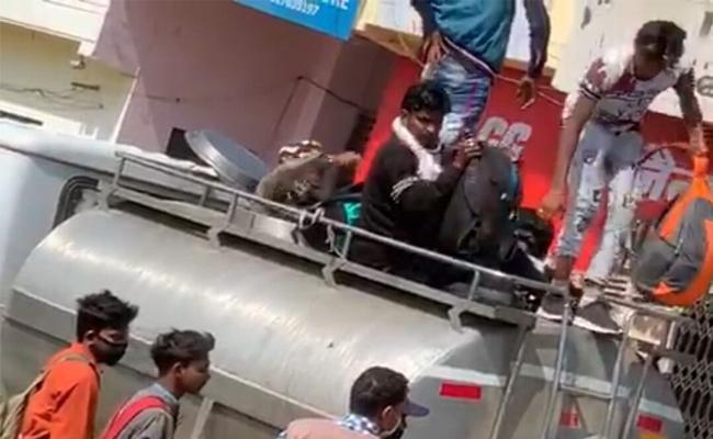 Corona Lockdown UP Men Hide In Milk Tank To Travel Home Town - Sakshi