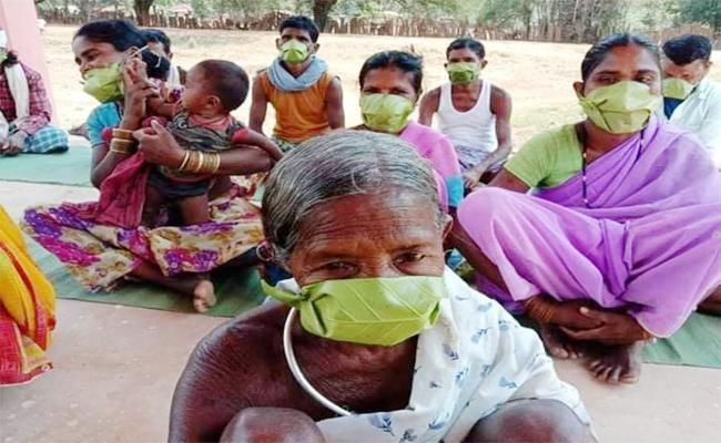 Odisha Tribal People Using Leaf Masks - Sakshi
