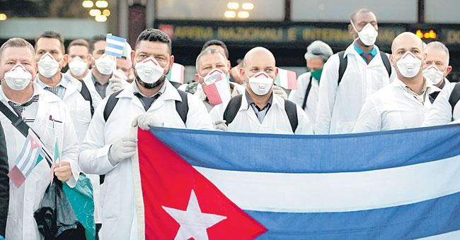 Cuban doctors and nurses arrive in Milan to help fight - Sakshi