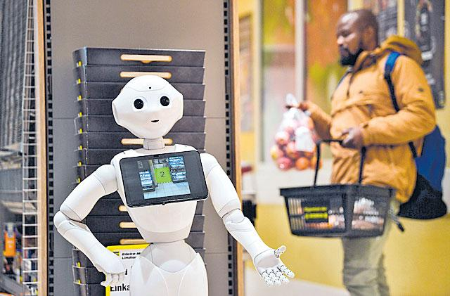 Robots help combat COVID-19 in world - Sakshi
