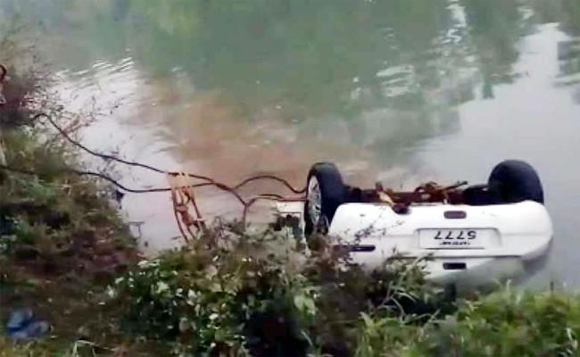 Car Rollover in Canal West Godavari - Sakshi
