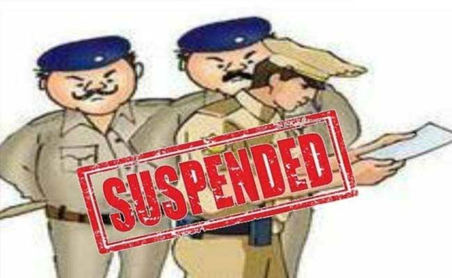 Constables Suspended For Assulting Female Conductor In Mahabubnagar  - Sakshi