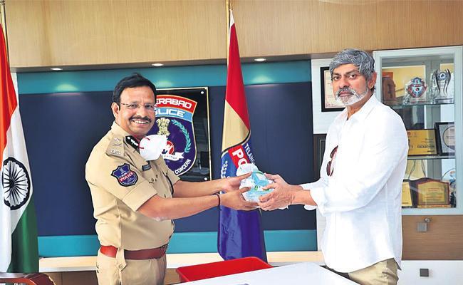 Actor Jagapathi Babu Distribute Masks And Sanitizers - Sakshi