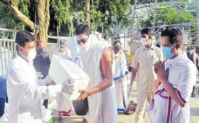 Distribution of essentials to poor priests - Sakshi