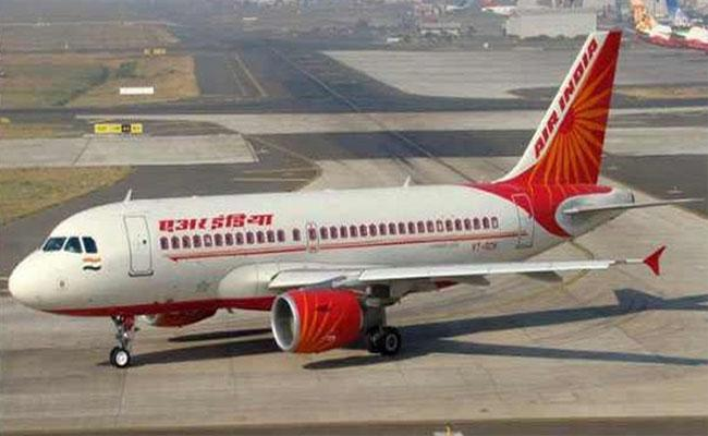 Corona effect: Air India suspends contract of around 200 pilots - Sakshi