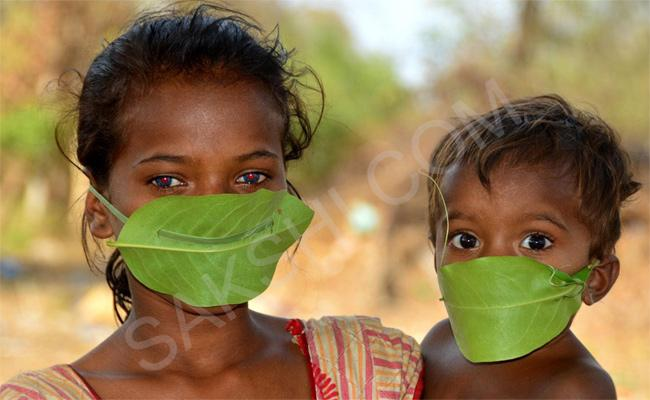 Tribal Wear Masks With Leaves Photo VIral In Social Media - Sakshi