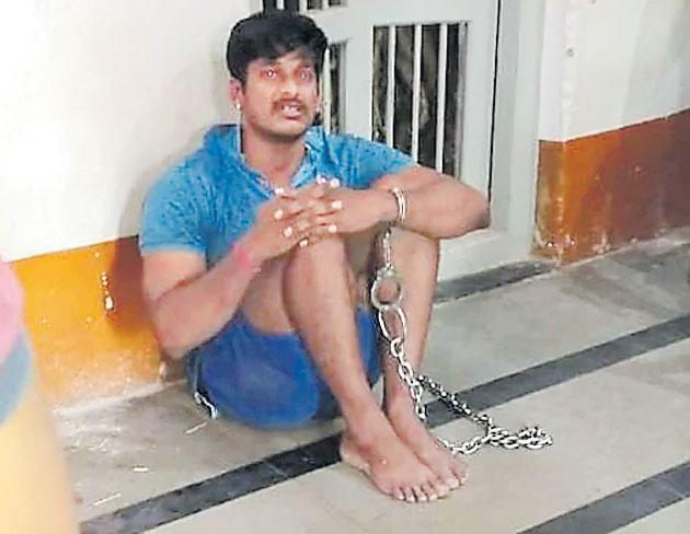 CoBRA jawan tied with chains at Karnataka police station - Sakshi