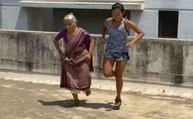 Milind Soman Mother Surprises With Her Workout and Push Ups At 81 - Sakshi