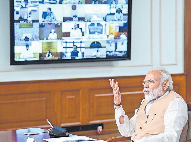 Prime Minister Narendra Modi hints at calibrated exit from lockdown - Sakshi