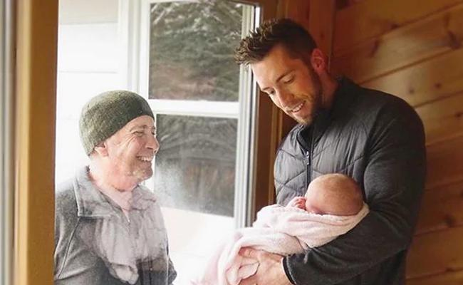 Grandfather Meets Newborn Granddaughter Through Window In Michigan - Sakshi