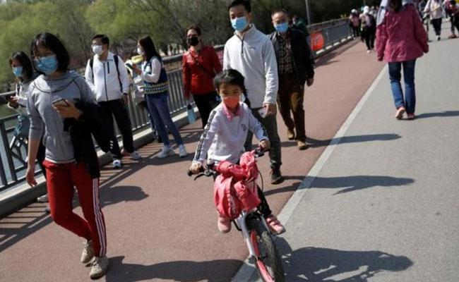 Coronavirus Pandemic Epicenter Wuhan ends 76 Day Lockdown - Sakshi