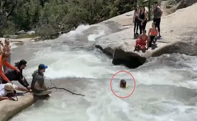 Viral Video Shows Officer Rescues Man Trapped In Whirlpool At California - Sakshi
