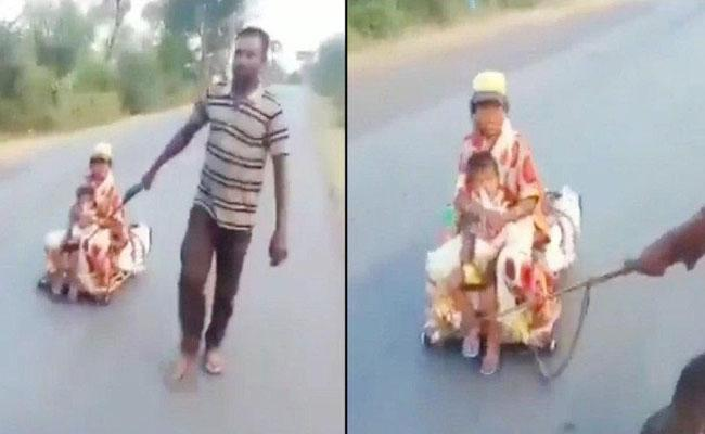 Migrant Worker Wheels Pregnant Wife Makeshift Cart From Hyderabad To MP - Sakshi