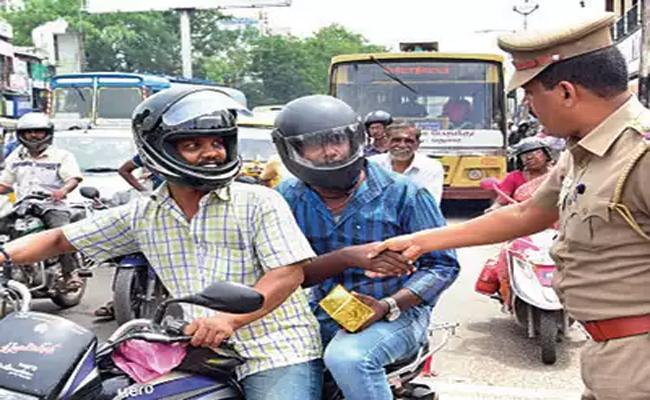 Sanitizer gift Two Wheeler Riders With Helmets in Hyderabad - Sakshi