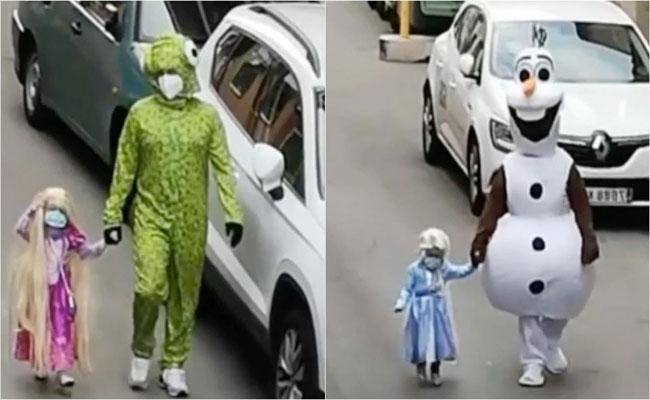 Spain Father And Daughter Duo Wear Special Dress To Throw Trash - Sakshi