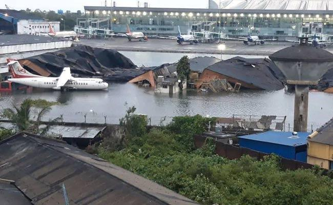 Amphan Cyclone:  Kolkata Airport flooded With Strong Winds - Sakshi