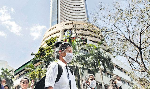Sensex rises over 100 points and Nifty at 9106points - Sakshi
