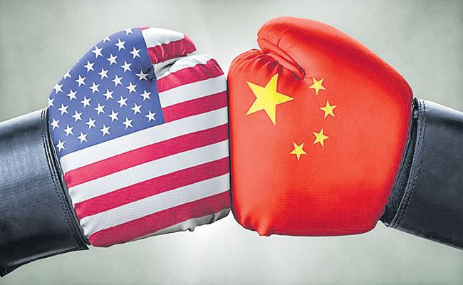 Chinese Foreign Minister Wang Yi warns against new China-US cold war - Sakshi