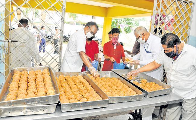 Huge response to Srivari Laddu Prasadam in first day sale - Sakshi