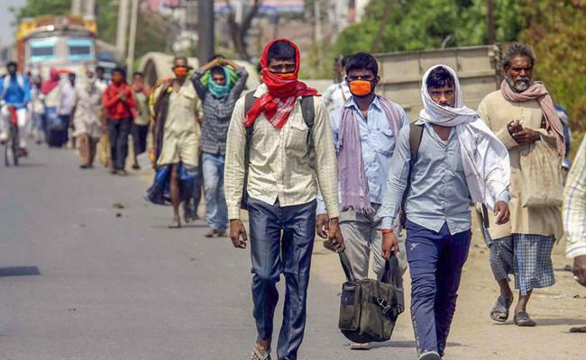 Nris help Migrant workers to reach their homes - Sakshi