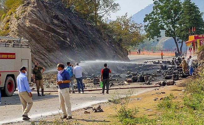Truck Catches Fire Multiple Lpg Cylinder Blasts Panic In Jammu Highway - Sakshi