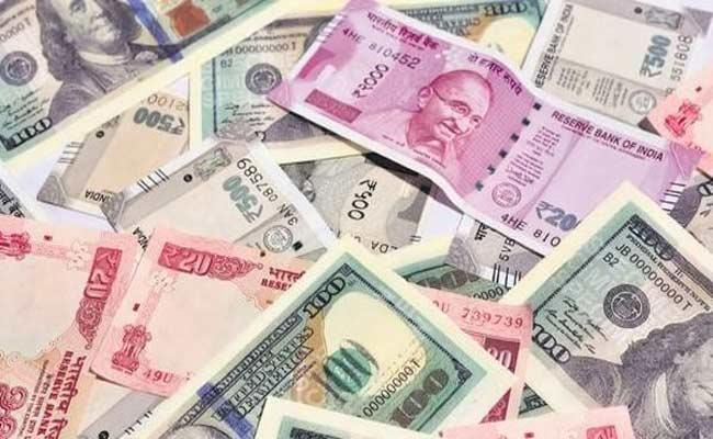 Rupee settles 14 paise higheragainst US dollar - Sakshi