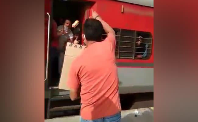 Railway Officer In UP Throws Biscuits At Migrants And Abuses Them - Sakshi