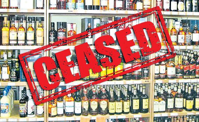 Liquor Shop License Cancelled Due To Violating Corona Regulations In Telangana - Sakshi