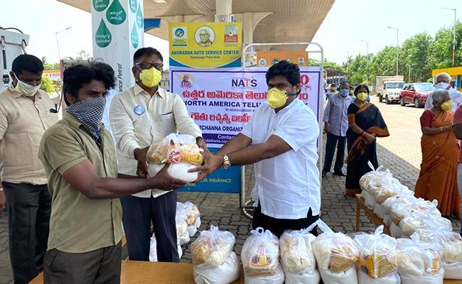NATS Donates food to poor in Telugu states - Sakshi