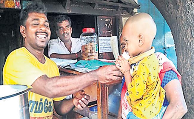 Tea Stall Owner Distribute Milk For Children - Sakshi