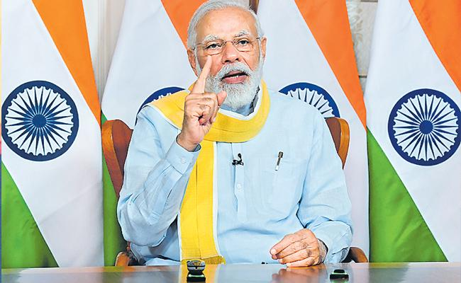 PM Narendra Modi pitches for Made in India products in healthcare - Sakshi