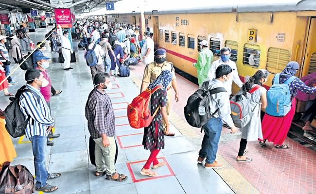 Health protocol in 18 railway stations in AP - Sakshi