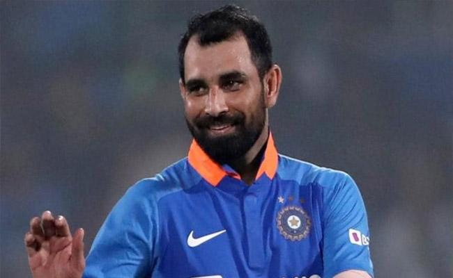 BCCI Shared A Video of Shami Helping Migrants Travelling Home - Sakshi