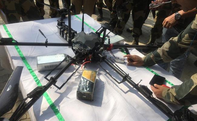 BSF shoots down Pakistani spy drone Jammu and Kashmir Kathua - Sakshi