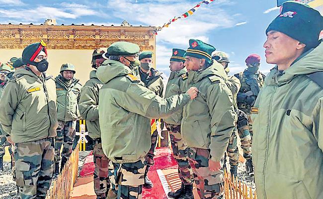 India-China hold diplomatic talks to ease border tension - Sakshi