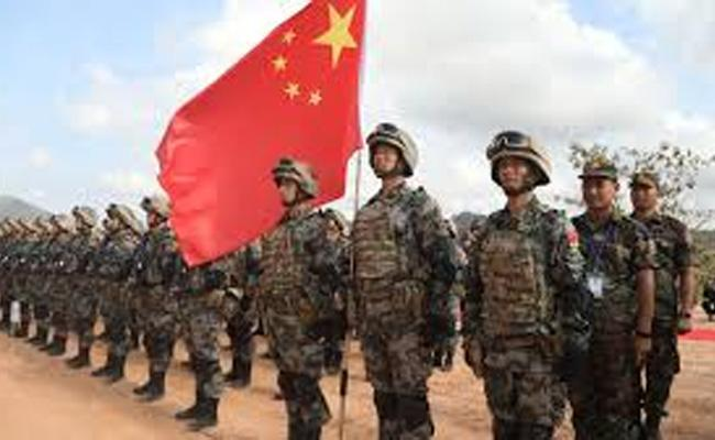 China of amassing troops along border in violation of agreements - Sakshi