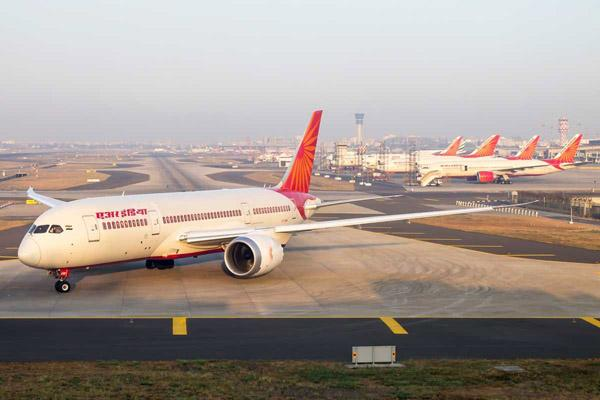 Families Of Diplomats Not Allowed On Special Flight To China - Sakshi