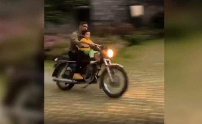 Dhoni Bike Ride With Ziva Again Their Farmhouse At Ranchi - Sakshi