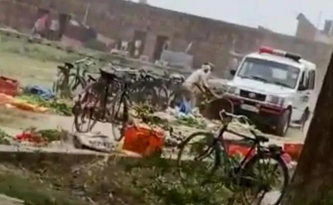 UP Cop Suspended Crushes Vegetables With Police Car - Sakshi