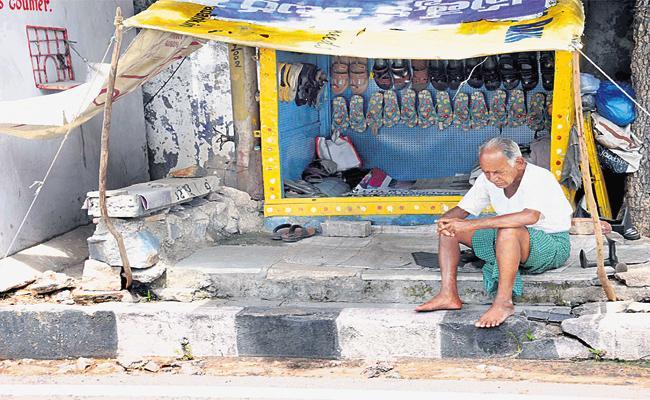 Slipper Shop Owner Worried on No Business Hyderabad - Sakshi